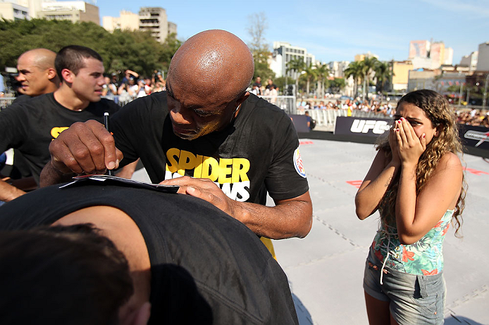 RIO DE JANEIRO, BRAZIL - OCTOBER 10:  Anderson Silva signs an autograph for a fan after an open training session ahead of UFC 153 at Arcos da Lapa: Praca Cardeal Camara on October 10, 2012 in Rio de Janeiro, Brazil.  (Photo by Josh Hedges/Zuffa LLC/Zuffa LLC via Getty Images)