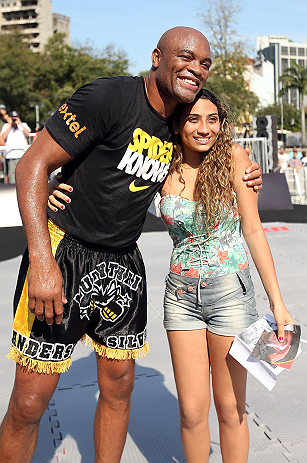RIO DE JANEIRO, BRAZIL - OCTOBER 10:  Anderson Silva poses for a photo with a fan after an open training session ahead of UFC 153 at Arcos da Lapa: Praca Cardeal Camara on October 10, 2012 in Rio de Janeiro, Brazil.  (Photo by Josh Hedges/Zuffa LLC/Zuffa LLC via Getty Images)
