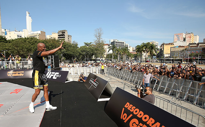 RIO DE JANEIRO, BRAZIL - OCTOBER 10:  Anderson Silva greets fans after an open training session ahead of UFC 153 at Arcos da Lapa: Praca Cardeal Camara on October 10, 2012 in Rio de Janeiro, Brazil.  (Photo by Josh Hedges/Zuffa LLC/Zuffa LLC via Getty Images)