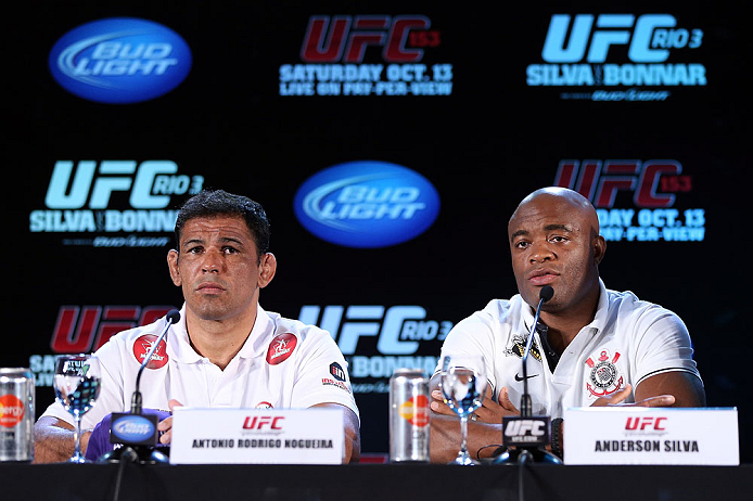 "RIO DE JANEIRO, BRAZIL - OCTOBER 11:  (R-L) Anderson Silva and Antonio Rodrigo ""Minotauro"" Nogueira interact with media during a press conference ahead of UFC 153 at Windsor Barra Hotel on October 11, 2012 in Rio de Janeiro, Brazil.  (Photo by Josh Hedges/Zuffa LLC/Zuffa LLC via Getty Images)"