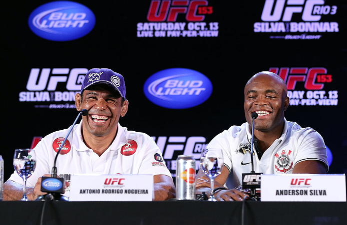 RIO DE JANEIRO, BRAZIL - OCTOBER 11:  (R-L) Anderson Silva and Minotauro Nogueira with media during a press conference ahead of UFC 153 at Windsor Barra Hotel on October 11, 2012 in Rio de Janeiro, Brazil.  (Photo by Josh Hedges/Zuffa LLC/Zuffa LLC via Getty Images)