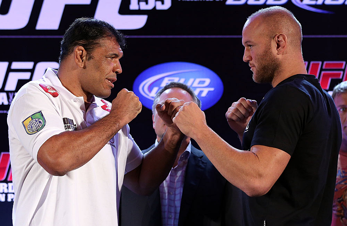 RIO DE JANEIRO, BRAZIL - OCTOBER 11:  (L-R) Opponents Minotauro Nogueira and Dave Herman face off during a press conference ahead of UFC 153 at Windsor Barra Hotel on October 11, 2012 in Rio de Janeiro, Brazil.  (Photo by Josh Hedges/Zuffa LLC/Zuffa LLC via Getty Images)