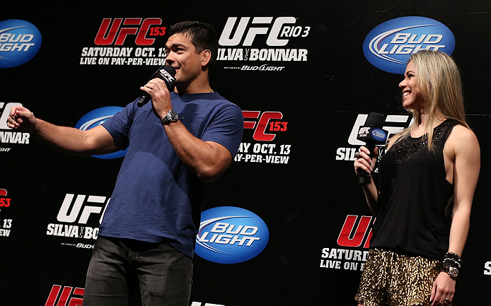 RIO DE JANEIRO, BRAZIL - OCTOBER 12:  (L-R) Lyoto Machida and Paula Sack interact with fans during a Q&amp;A session before the UFC 153 weigh in at HSBC Arena on October 12, 2012 in Rio de Janeiro, Brazil.  (Photo by Josh Hedges/Zuffa LLC/Zuffa LLC via Getty Images)