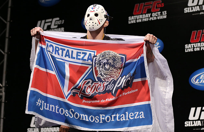 "RIO DE JANEIRO, BRAZIL - OCTOBER 12:  Rony ""Jason"" Mariano Bezerra displays a flag on stage before weighing in during the UFC 153 weigh in at HSBC Arena on October 12, 2012 in Rio de Janeiro, Brazil.  (Photo by Josh Hedges/Zuffa LLC/Zuffa LLC via Getty Images)"