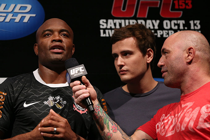 RIO DE JANEIRO, BRAZIL - OCTOBER 12:  Anderson Silva (L) is interviewed by Joe Rogan (R) during the UFC 153 weigh in at HSBC Arena on October 12, 2012 in Rio de Janeiro, Brazil.  (Photo by Josh Hedges/Zuffa LLC/Zuffa LLC via Getty Images)