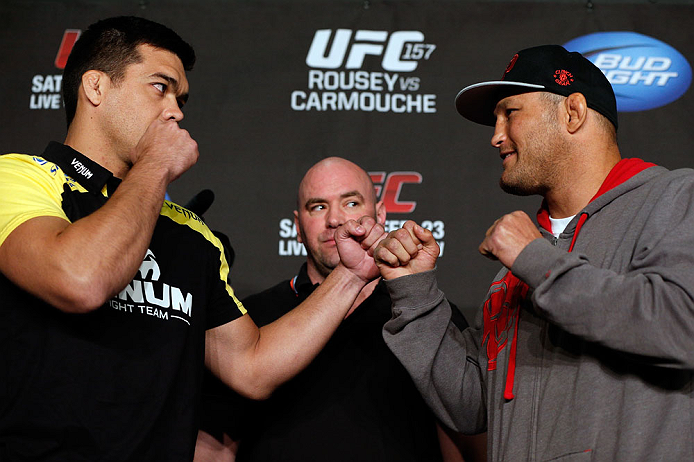 ANAHEIM, CA - FEBRUARY 21:  (L-R) Opponents Lyoto Machida and Dan Henderson face off during a UFC pre-fight press conference at Honda Center on February 21, 2013 in Anaheim, California.  (Photo by Josh Hedges/Zuffa LLC/Zuffa LLC via Getty Images)