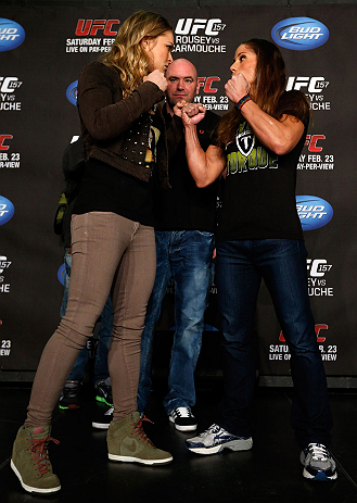 ANAHEIM, CA - FEBRUARY 21:  (L-R) Opponents Ronda Rousey and Liz Carmouche face off during a UFC pre-fight press conference at Honda Center on February 21, 2013 in Anaheim, California.  (Photo by Josh Hedges/Zuffa LLC/Zuffa LLC via Getty Images)