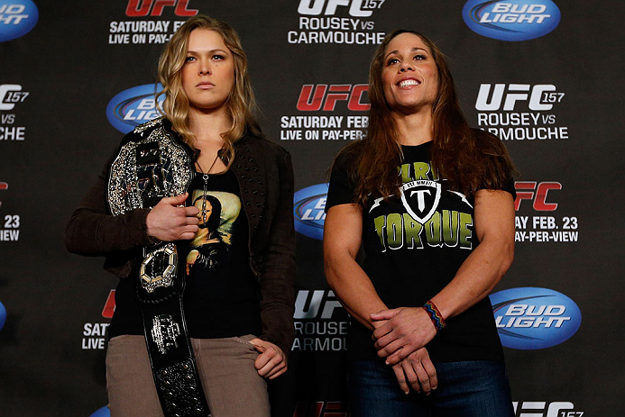 ANAHEIM, CA - FEBRUARY 21:  (L-R) Opponents Ronda Rousey and Liz Carmouche pose for photos during a UFC pre-fight press conference at Honda Center on February 21, 2013 in Anaheim, California.  (Photo by Josh Hedges/Zuffa LLC/Zuffa LLC via Getty Images)