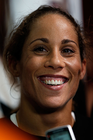 TORRANCE, CA - FEBRUARY 20:  Liz Carmouche interacts with media after an open training session at the UFC Gym on February 20, 2013 in Torrance, California.  (Photo by Josh Hedges/Zuffa LLC/Zuffa LLC via Getty Images)