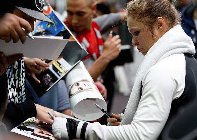 Rousey signs autographs for fans at open workout