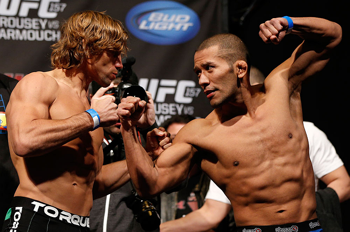 ANAHEIM, CA - FEBRUARY 22:  (L-R) Opponents Urijah Faber and Ivan Menjivar face off during the UFC 157 weigh-in at Honda Center on February 22, 2013 in Anaheim, California.  (Photo by Josh Hedges/Zuffa LLC/Zuffa LLC via Getty Images)