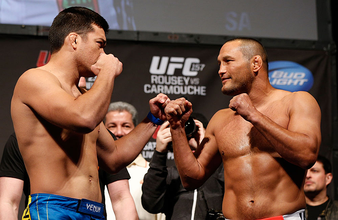 ANAHEIM, CA - FEBRUARY 22:  (L-R) Opponents Lyoto Machida and Dan Henderson face off during the UFC 157 weigh-in at Honda Center on February 22, 2013 in Anaheim, California.  (Photo by Josh Hedges/Zuffa LLC/Zuffa LLC via Getty Images)