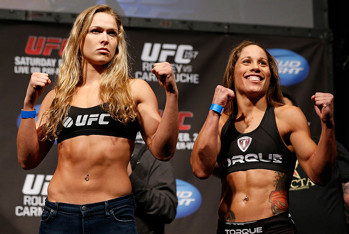 ANAHEIM, CA - FEBRUARY 22:  (L-R) Opponents Ronda Rousey and Liz Carmouche pose for photos during the UFC 157 weigh-in at Honda Center on February 22, 2013 in Anaheim, California.  (Photo by Josh Hedges/Zuffa LLC/Zuffa LLC via Getty Images)