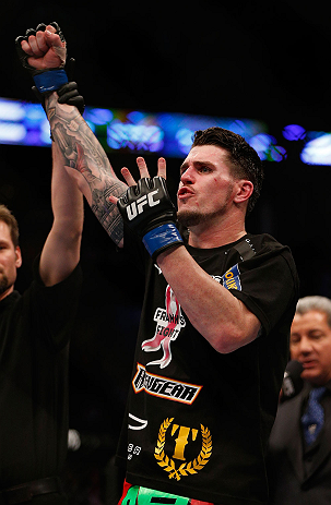 Chris Camozzi reacts after defeating <a href='../fighter/Nick-Ring'><a href='../fighter/Nick-Ring'>Nick Ring</a></a> in their middleweight bout during the UFC 158 event at Bell Centre on March 16, 2013 in Montreal, Quebec, Canada. (Photo by Josh Hedges/Zuffa LLC)