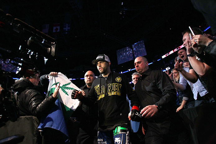 MONTREAL, QC - MARCH 16:  Carlos Condit enters the arena before his welterweight bout against Johny Hendricks during the UFC 158 event at Bell Centre on March 16, 2013 in Montreal, Quebec, Canada.  (Photo by Jonathan Ferrey/Zuffa LLC/Zuffa LLC via Getty Images)