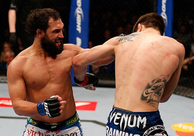 MONTREAL, QC - MARCH 16:  (L-R) Johny Hendricks punches Carlos Condit in their welterweight bout during the UFC 158 event at Bell Centre on March 16, 2013 in Montreal, Quebec, Canada.  (Photo by Josh Hedges/Zuffa LLC/Zuffa LLC via Getty Images)