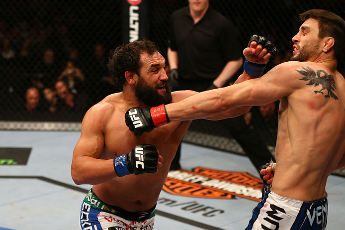 MONTREAL, QC - MARCH 16:  (L-R) Johny Hendricks punches Carlos Condit in their welterweight bout during the UFC 158 event at Bell Centre on March 16, 2013 in Montreal, Quebec, Canada.  (Photo by Jonathan Ferrey/Zuffa LLC/Zuffa LLC via Getty Images)