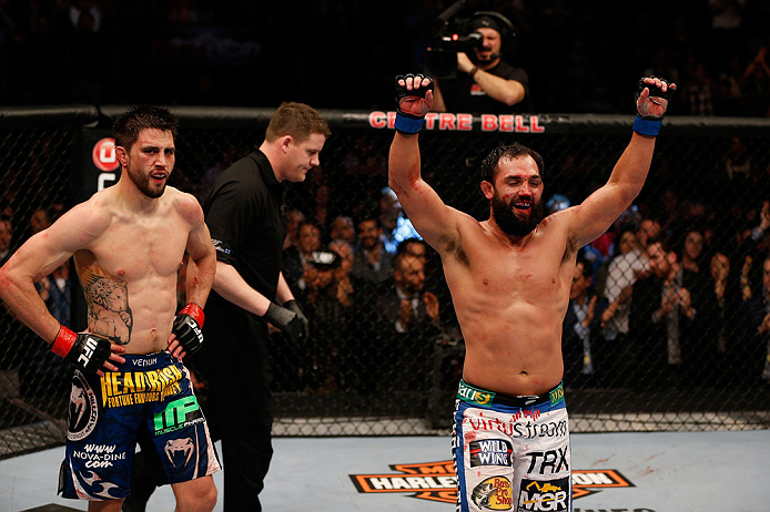 MONTREAL, QC - MARCH 16:  (R-L) Johny Hendricks and Carlos Condit react after the conclusion of their welterweight bout during the UFC 158 event at Bell Centre on March 16, 2013 in Montreal, Quebec, Canada.  (Photo by Josh Hedges/Zuffa LLC/Zuffa LLC via Getty Images)