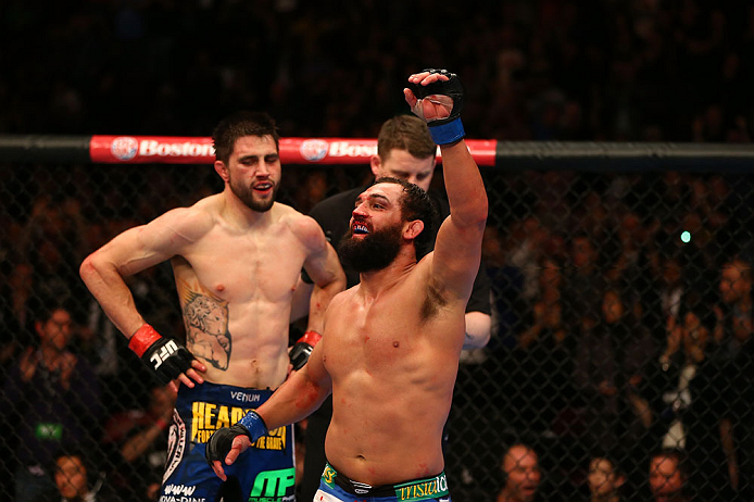 MONTREAL, QC - MARCH 16:  (R-L) Johny Hendricks reacts after the conclusion of his welterweight bout against Carlos Condit during the UFC 158 event at Bell Centre on March 16, 2013 in Montreal, Quebec, Canada.  (Photo by Jonathan Ferrey/Zuffa LLC/Zuffa LLC via Getty Images)