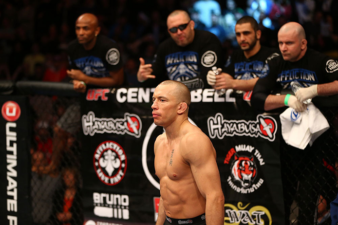 MONTREAL, QC - MARCH 16:  Georges St-Pierre stands in the Octagon before his welterweight championship bout against Nick Diaz during the UFC 158 event at Bell Centre on March 16, 2013 in Montreal, Quebec, Canada.  (Photo by Jonathan Ferrey/Zuffa LLC/Zuffa LLC via Getty Images)