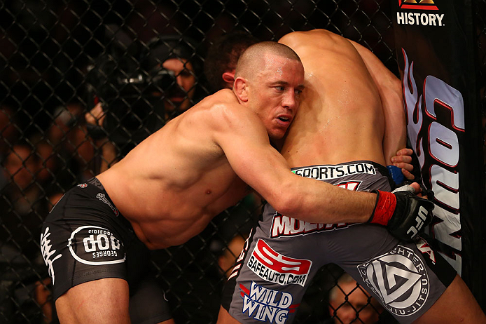 MONTREAL, QC - MARCH 16: (L-R) Georges St-Pierre grapples with Nick Diaz in their welterweight championship bout during the UFC 158 event at Bell Centre on March 16, 2013 in Montreal, Quebec, Canada.  (Photo by Jonathan Ferrey/Zuffa LLC/Zuffa LLC via Getty Images)