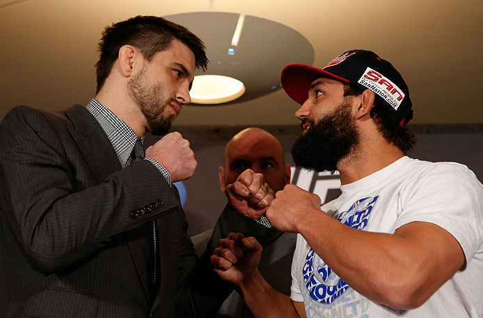 MONTREAL, QC - MARCH 14:  (L-R) Opponents Carlos Condit and Johny Hendricks face off during the final press conference ahead of his UFC 158 bout at Bell Centre on March 14, 2013 in Montreal, Quebec, Canada.  (Photo by Josh Hedges/Zuffa LLC/Zuffa LLC via Getty Images)