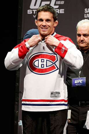 MONTREAL, QC - MARCH 15: Jake Ellenberger sporting the home teams hockey jersey during the UFC 158 weigh-in at Bell Centre on March 15, 2013 in Montreal, Quebec, Canada.  (Photo by Josh Hedges/Zuffa LLC/Zuffa LLC via Getty Images)
