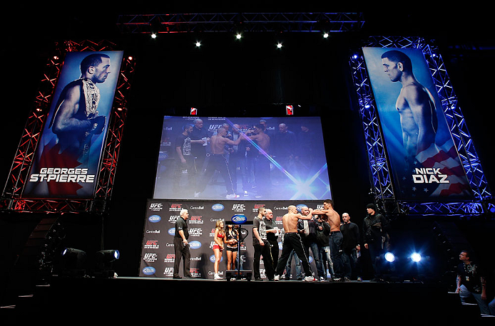 MONTREAL, QC - MARCH 15:  (L-R) Opponents Georges St-Pierre and Nick Diaz face off during the UFC 158 weigh-in at Bell Centre on March 15, 2013 in Montreal, Quebec, Canada.  (Photo by Josh Hedges/Zuffa LLC/Zuffa LLC via Getty Images)