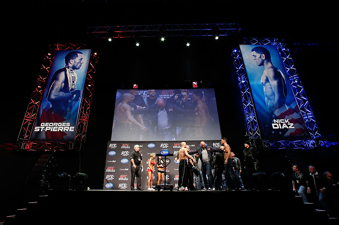 MONTREAL, QC - MARCH 15:  (L-R) Opponents Georges St-Pierre and Nick Diaz are separated by UFC president Dana White during the UFC 158 weigh-in at Bell Centre on March 15, 2013 in Montreal, Quebec, Canada.  (Photo by Josh Hedges/Zuffa LLC/Zuffa LLC via Getty Images)