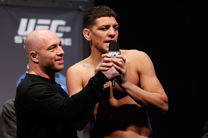 MONTREAL, QC - MARCH 15:  Nick Diaz speaks with Joe Rogan during the UFC 158 weigh-in at Bell Centre on March 15, 2013 in Montreal, Quebec, Canada.  (Photo by Josh Hedges/Zuffa LLC/Zuffa LLC via Getty Images)