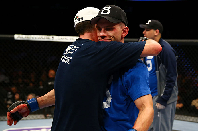 NEWARK, NJ - APRIL 27:  Steven Siler (L) is hugs opponent Kurt Holobaugh (R) after winning their featherweight bout by unanimous decision during the UFC 159 event at the Prudential Center on April 27, 2013 in Newark, New Jersey.  (Photo by Al Bello/Zuffa LLC/Zuffa LLC Via Getty Images)