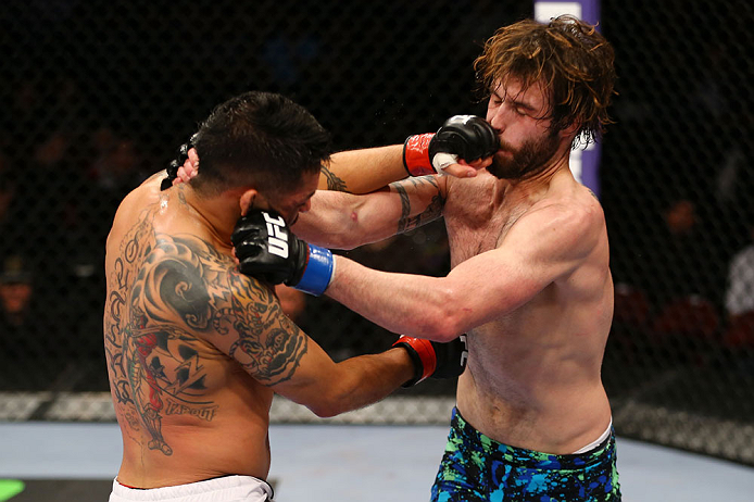 NEWARK, NJ - APRIL 27: (L-R) Leonard Garcia and Cody McKenzie exchange punches in their featherweight bout during the UFC 159 event at the Prudential Center on April 27, 2013 in Newark, New Jersey.  (Photo by Al Bello/Zuffa LLC/Zuffa LLC Via Getty Images)