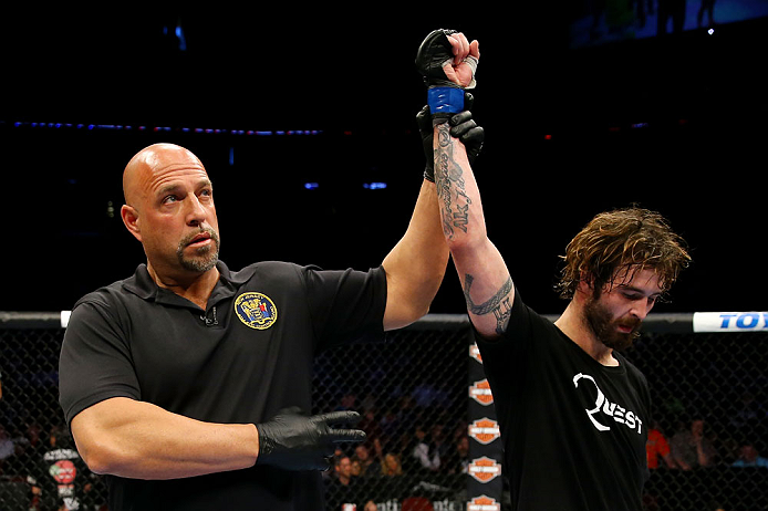 NEWARK, NJ - APRIL 27: Referee Dan Miragliotta announces Cody McKenzie winner by unanimous decision against Leonard Garcia in their featherweight bout during the UFC 159 event at the Prudential Center on April 27, 2013 in Newark, New Jersey.  (Photo by Al Bello/Zuffa LLC/Zuffa LLC Via Getty Images)