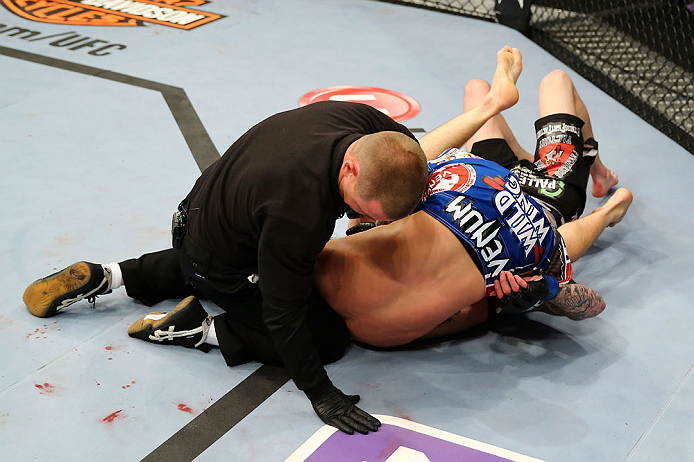 NEWARK, NJ - APRIL 27:  Bryan Caraway submits Johnny Bedford with a  guillotine choke as the referee calls the match in their bantamweight bout during the UFC 159 event at the Prudential Center on April 27, 2013 in Newark, New Jersey.  (Photo by Al Bello/Zuffa LLC/Zuffa LLC Via Getty Images)