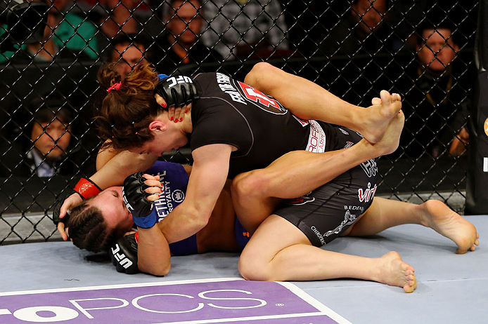 NEWARK, NJ - APRIL 27: Sara McMann (top) battles against Sheila Gaff (bottom) in round one of their women's bantamweight bout during the UFC 159 event at the Prudential Center on April 27, 2013 in Newark, New Jersey.  (Photo by Al Bello/Zuffa LLC/Zuffa LLC Via Getty Images)