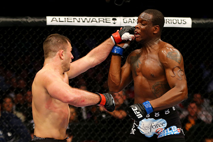 NEWARK, NJ - APRIL 27: (L-R) Gian Villante throws a punch against Ovince Saint Preux in their light heavyweight bout during the UFC 159 event at the Prudential Center on April 27, 2013 in Newark, New Jersey.  (Photo by Al Bello/Zuffa LLC/Zuffa LLC Via Getty Images)