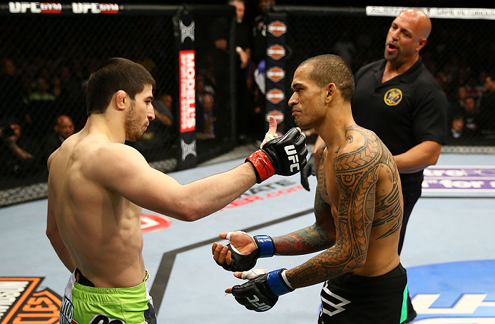 NEWARK, NJ - APRIL 27:  Yancy Medeiros (R) shows his injury to Rustam Khabilov (L) of Russia after the stoppage of their lightweight bout during the UFC 159 event at the Prudential Center on April 27, 2013 in Newark, New Jersey.  (Photo by Al Bello/Zuffa LLC/Zuffa LLC Via Getty Images)