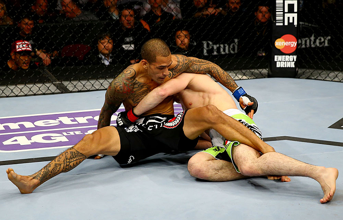 NEWARK, NJ - APRIL 27: Yancy Medeiros (L) struggles against Rustam Khabilov (R) of Russia in their lightweight bout during the UFC 159 event at the Prudential Center on April 27, 2013 in Newark, New Jersey.  (Photo by Al Bello/Zuffa LLC/Zuffa LLC Via Getty Images)