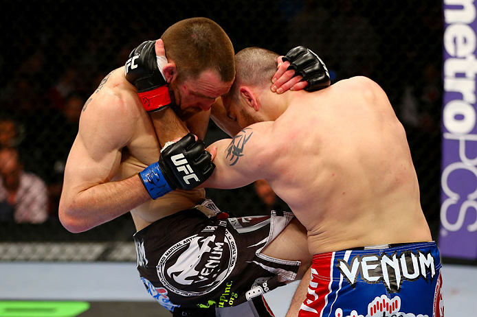 NEWARK, NJ - APRIL 27: Pat Healy (L) knees Jim Miller (R) in their lightweight bout during the UFC 159 event at the Prudential Center on April 27, 2013 in Newark, New Jersey.  (Photo by Al Bello/Zuffa LLC/Zuffa LLC Via Getty Images)