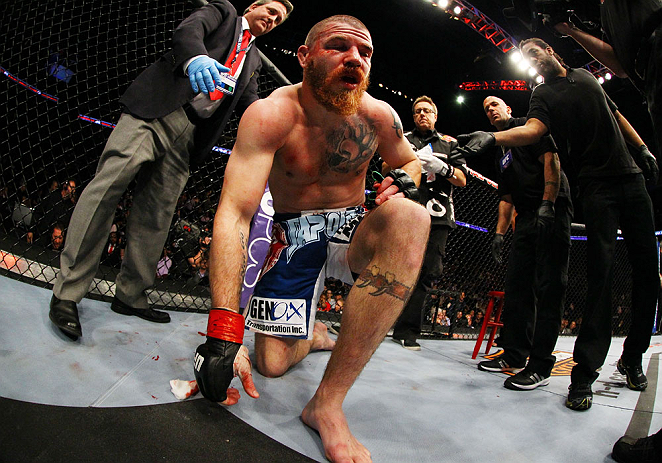 NEWARK, NJ - APRIL 27: Jim Miller stands up after losing by TKO (rear-naked choke) to Pat Healy in the third round of their lightweight bout during the UFC 159 event at the Prudential Center on April 27, 2013 in Newark, New Jersey.  (Photo by Al Bello/Zuffa LLC/Zuffa LLC Via Getty Images)