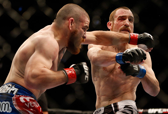 NEWARK, NJ - APRIL 27:   (L-R) Jim Miller punches Pat Healy in their lightweight fight during the UFC 159 event at the Prudential Center on April 27, 2013 in Newark, New Jersey.  (Photo by Josh Hedges/Zuffa LLC/Zuffa LLC via Getty Images)