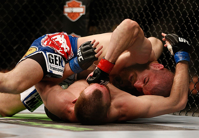 NEWARK, NJ - APRIL 27:   Jim Miller (top) punches Pat Healy in their lightweight fight during the UFC 159 event at the Prudential Center on April 27, 2013 in Newark, New Jersey.  (Photo by Josh Hedges/Zuffa LLC/Zuffa LLC via Getty Images)