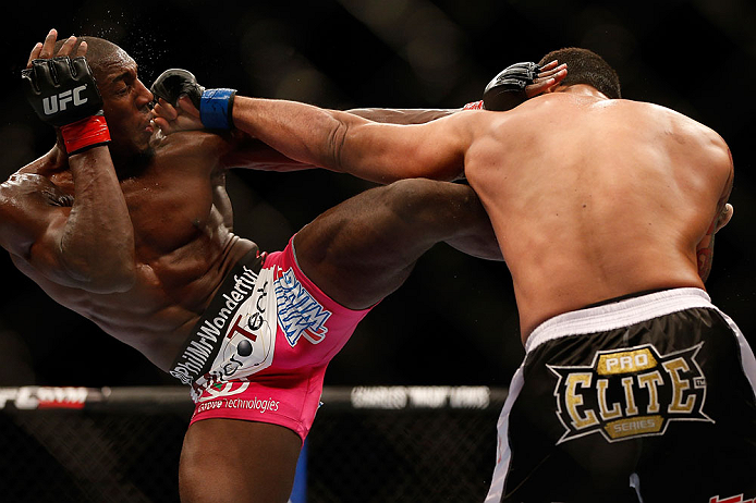 NEWARK, NJ - APRIL 27:   (L-R) Phil Davis and Vinny Magalhaes trade strikes in their light heavyweight fight during the UFC 159 event at the Prudential Center on April 27, 2013 in Newark, New Jersey.  (Photo by Josh Hedges/Zuffa LLC/Zuffa LLC via Getty Images)