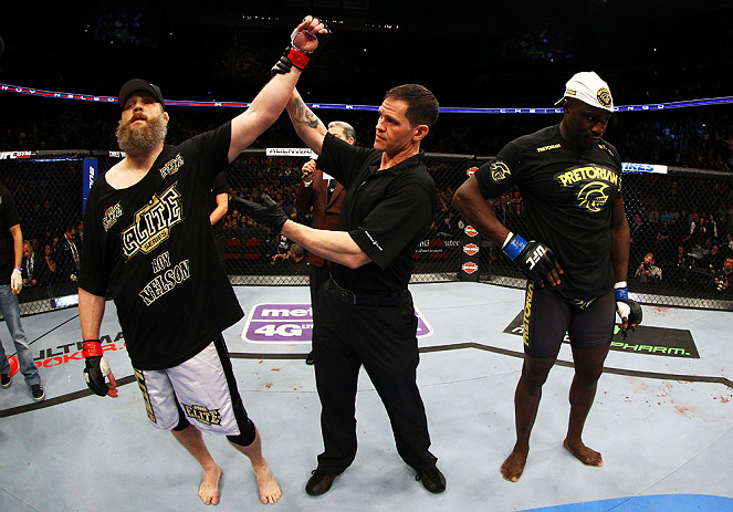 NEWARK, NJ - APRIL 27:  Cheick Kongo (R) of France reacts as Roy Nelson (L) is announced winner by knockout by referee Kevin Mulhall (C) after their heavyweight bout during the UFC 159 event at the Prudential Center on April 27, 2013 in Newark, New Jersey.  (Photo by Al Bello/Zuffa LLC/Zuffa LLC Via Getty Images)