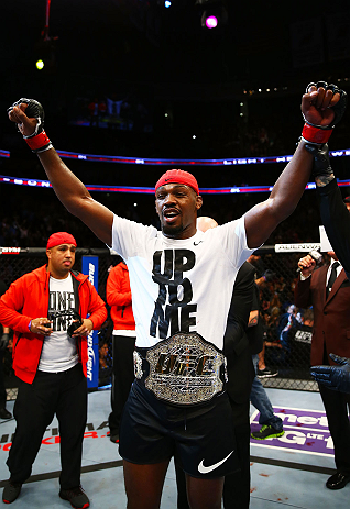 NEWARK, NJ - APRIL 27:  Jon Jones is awarded the championship belt and announced winner by knockout against Chael Sonnen after their light heavyweight championship bout during the UFC 159 event at the Prudential Center on April 27, 2013 in Newark, New Jersey.  (Photo by Al Bello/Zuffa LLC/Zuffa LLC Via Getty Images)