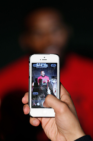 "NEW YORK, NY - APRIL 25:   UFC Light Heavyweight Champion Jon ""Bones"" Jones is seen on an iPhone screen as he interacts with media during UFC 159 media day at The Theater at Madison Square Garden on April 25, 2013 in New York City.  (Photo by Josh Hedges/Zuffa LLC/Zuffa LLC via Getty Images)"