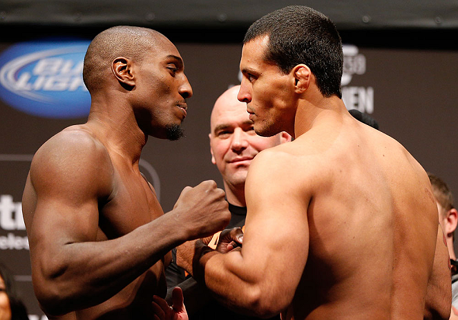 NEWARK, NJ - APRIL 26:   (L-R) Opponents Phil Davis and Vinny Magalhaes face off during the UFC 159 weigh-in event at the Prudential Center on April 26, 2013 in Newark, New Jersey.  (Photo by Josh Hedges/Zuffa LLC/Zuffa LLC via Getty Images)