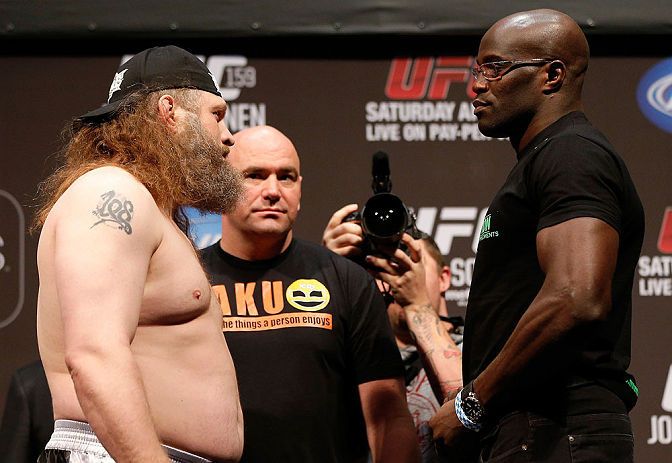 NEWARK, NJ - APRIL 26:   (L-R) Opponents Roy Nelson and Cheick Kongo face off during the UFC 159 weigh-in event at the Prudential Center on April 26, 2013 in Newark, New Jersey.  (Photo by Josh Hedges/Zuffa LLC/Zuffa LLC via Getty Images)