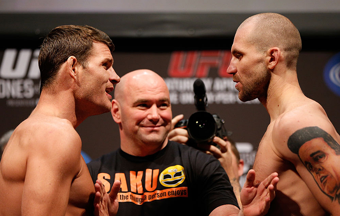 NEWARK, NJ - APRIL 26:   (L-R) Opponents Michael Bisping and Alan Belcher face off during the UFC 159 weigh-in event at the Prudential Center on April 26, 2013 in Newark, New Jersey.  (Photo by Josh Hedges/Zuffa LLC/Zuffa LLC via Getty Images)