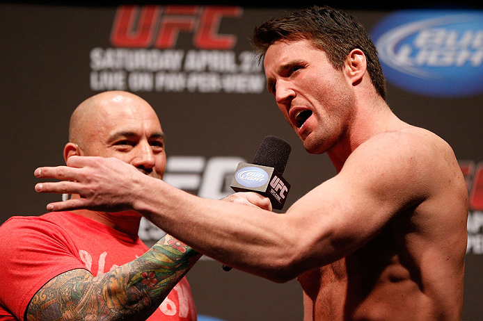 NEWARK, NJ - APRIL 26:   (R-L) Chael Sonnen is interviewed by Joe Rogan during the UFC 159 weigh-in event at the Prudential Center on April 26, 2013 in Newark, New Jersey.  (Photo by Josh Hedges/Zuffa LLC/Zuffa LLC via Getty Images)